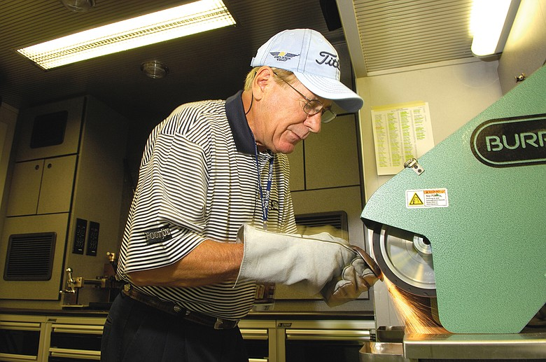 Bob Vokey grinds a wedge.