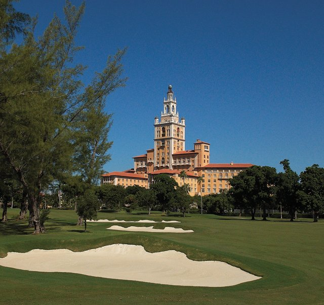 The Biltmore hotel rises majestically over Donald Ross renovated 1925 course as refurbished bunkers line the 18th.