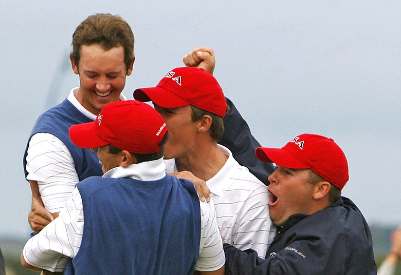 Jonathan Moore (left) celebrates with his teammates after making an eagle putt that helped the U.S to retain the Walker Cup in 2007.