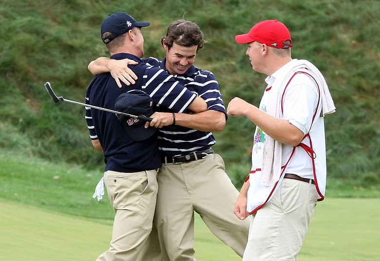 Brian Harman and Morgan Hoffman of the U.S. celebrate Harman holing their winning putt at the 17th in Saturday's morning foursomes.