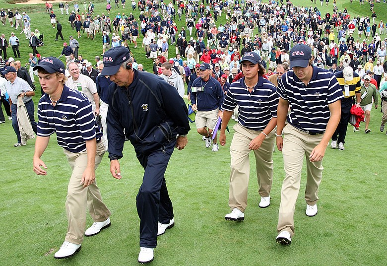 Bud Cauley, U.S. captain Buddy Marucci, Rickie Fowler and Peter Uihlein march off the course after taking a 3-1 lead in morning foursome matches.