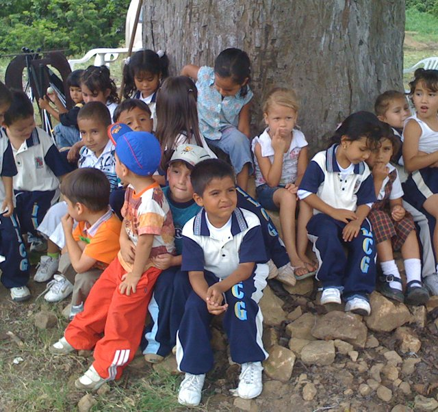 Children gather at Anthony Ciabattoni&#39;s golf facility near Bucaramanga, Colombia.