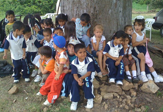 Children gather at Anthony Ciabattoni's golf facility near Bucaramanga, Colombia.