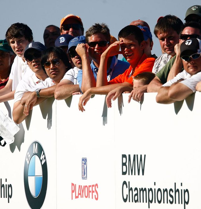 Fans watch the play on the 17th hole during the final round of the BMW Championship.