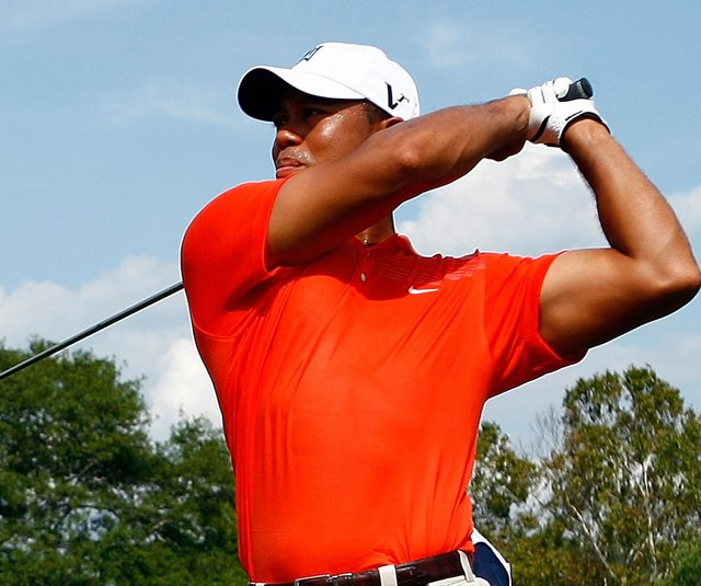 Tiger Woods hits his tee shot on the seventh hole during the second round of the Tour Championship.