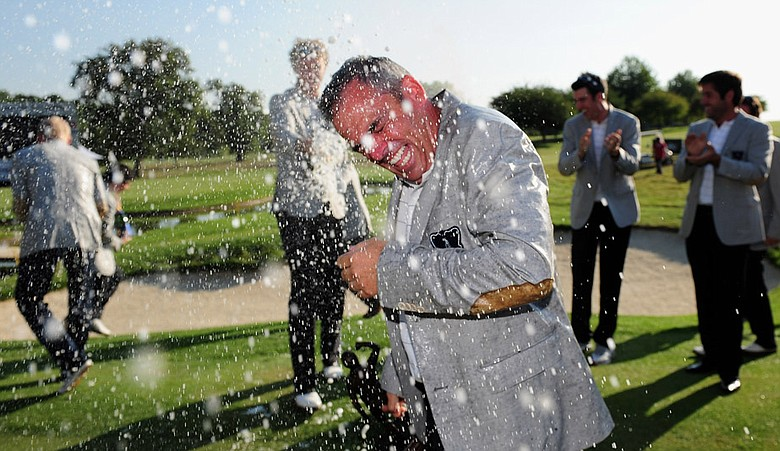 GB&I captain Paul McGinley gets sprayed with champagne by team members after winning the final day singles matches at the Vivendi Trophy.