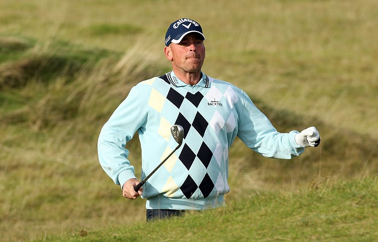 Thomas Bjorn plays his second shot at the sixth hole at Kingsbarns during the first round of the Alfred Dunhill Links Championship.