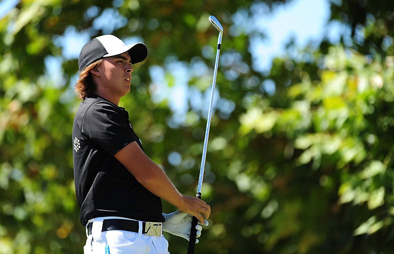 Rickie Fowler birdied his final two holes to shoot a 6-under 65 Friday.
