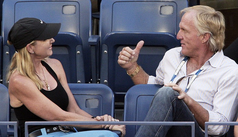 Chris Evert and Greg Norman watch a semifinal match at the U.S. Open tennis tournament in September.