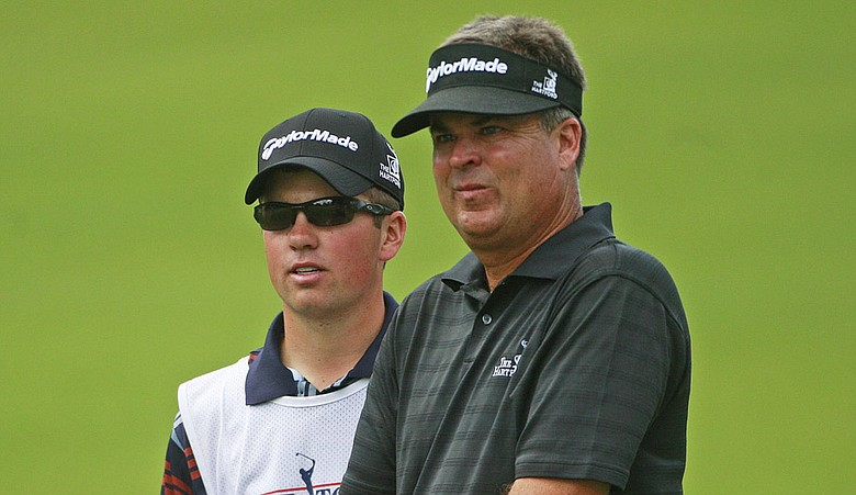 Kenny Perry talks with his son and caddie, Justin, during the final round of the Tour Championship.