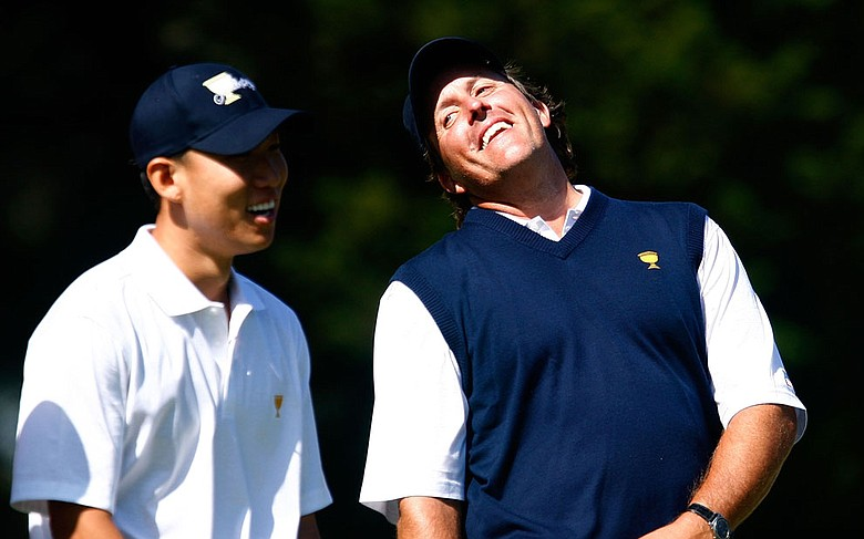 Phil Mickelson shares a laugh with Anthony Kim during the Tuesday practice round at the Presidents Cup.