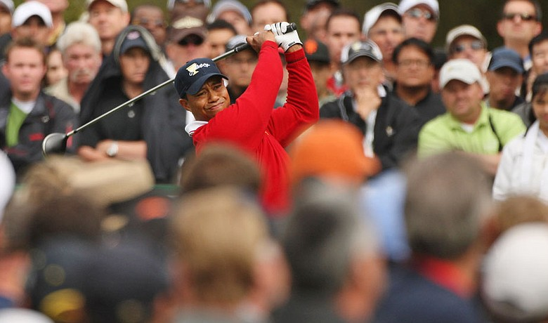 Tiger Woods tees off on the third hole Oct. 8 during the Day 1 at the Presidents Cup.