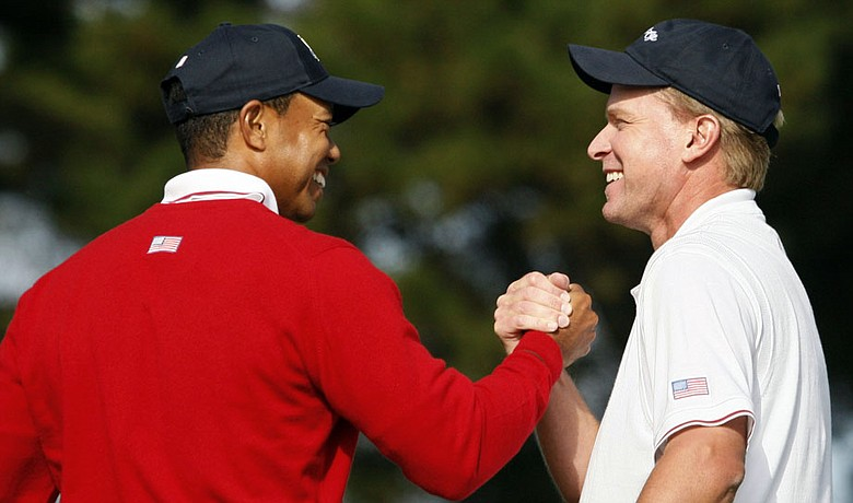 Tiger Woods and Steve Stricker celebrate their 6-and-4 win over Geoff Ogilvy and Ryo Ishikawa Oct. 8 at the Presidents Cup.