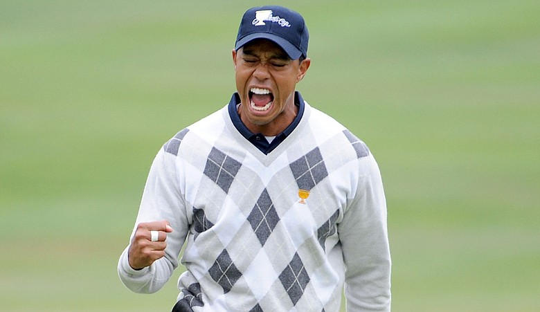 Tiger Woods celebrates his birdie putt that won 17th hole Oct. 10 at the Presidents Cup.