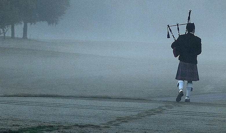 "Bagpiper Steve Agan plays ""Going Home"" as he leaves a memorial service for Payne Stewart at the Tour Championship in Houston on Oct. 28, 1999."