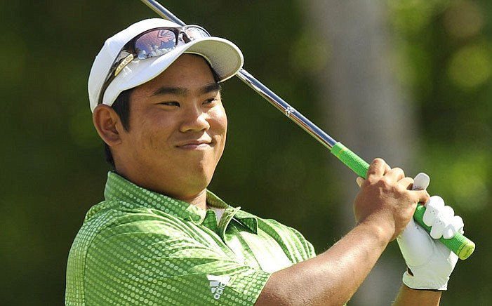 Tadd Fujikawa smiles at the first tee box during the final round of the 2009 Sony Open.