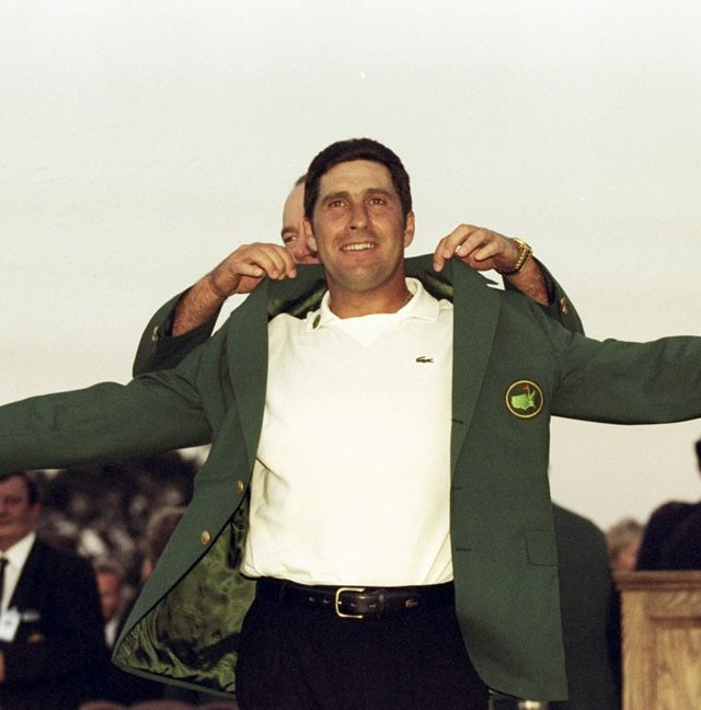 Jose Maria Olazabal puts on the green jacket after winning the 1999 Masters.