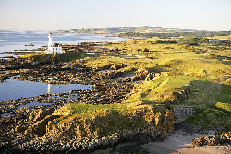 An aerial view of the par-4 9th hole that runs past the lighthouse on the Ailsa Course at The Westin Turnberry Resort.