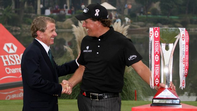PGA Tour commissioner Tim Finchem congratulates Phil Mickelson after his victory at the WGC-HSBC Champions Nov. 8 at Sheshan International Golf Club in Shanghai, China.