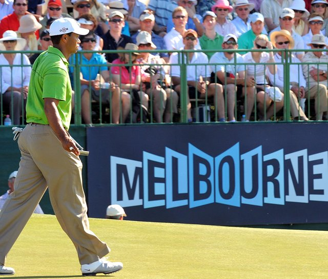 Tiger Woods walks past a packed gallery during his first practice round for the Australian Masters – his first tournament in Australia for 11 years.