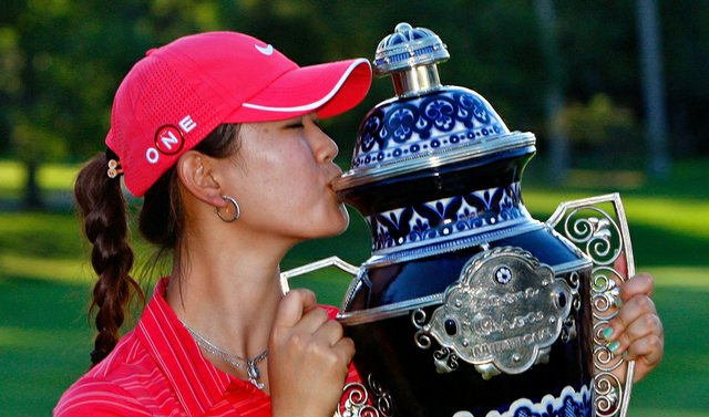 Michelle Wie kisses the trophy after winning the Lorena Ochoa Invitational on Nov. 15.