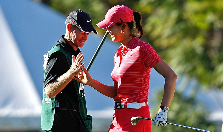 Brendan Woolley, left, and Michelle Wie at the LPGA Lorena Ochoa Invitational.