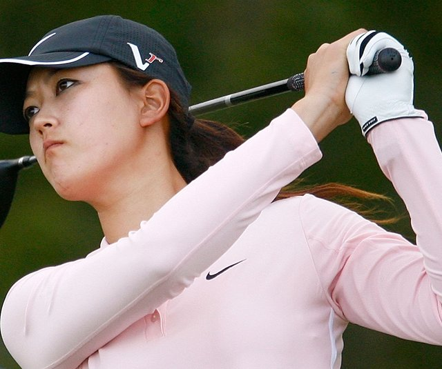 Michelle Wie hits her tee shot on the 14th hole at the LPGA Tour Championship.