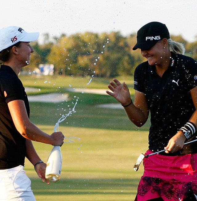 Anna Nordqvist (right) celebrates with fellow Swede Louise Stahle after her two-stroke victory at the LPGA Tour Championship.