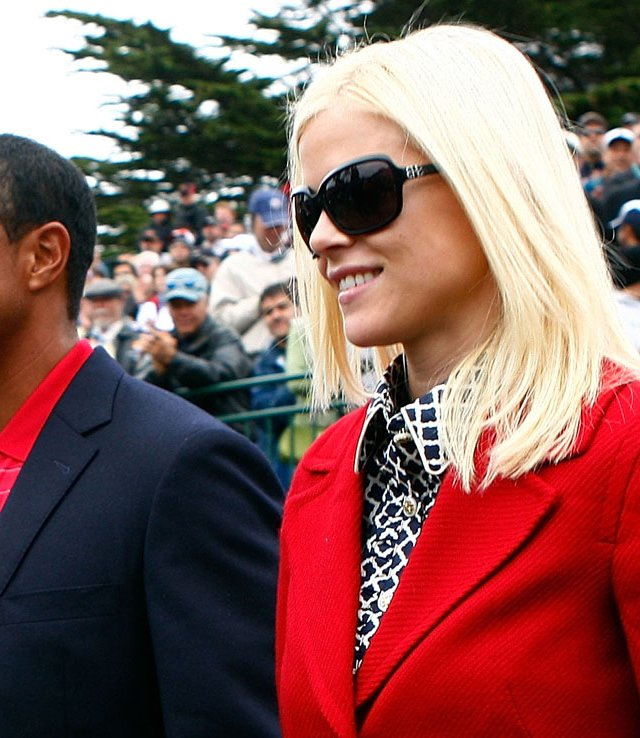 Tiger Woods walks with his wife, Elin, during the closing ceremonies of the Presidents Cup in October.