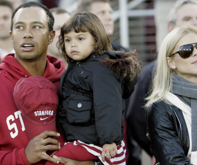 Tiger Woods with his daughter Sam and wife Elin.