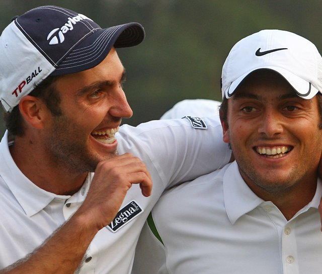 Francesco Molinari (right) and Edoardo Molinari celebrate after winning the Omega Mission Hills World Cup.
