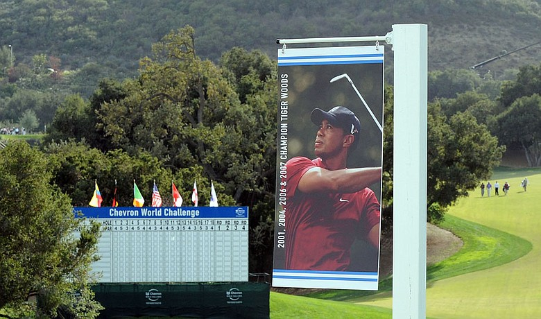 A sign of Tiger Woods overlooks the 18th green at the Chevron World Challenge. Woods withdrew from the tournament citing injuries from his Nov. 27 SUV accident.