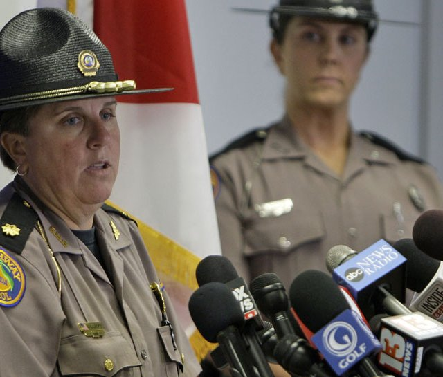 Maj. Cindy Williams (left) with the Florida Highway Patrol during a Dec. 1 news conference concerning Tiger Woods&#39; accident. Sgt. Kim Montes looks on.