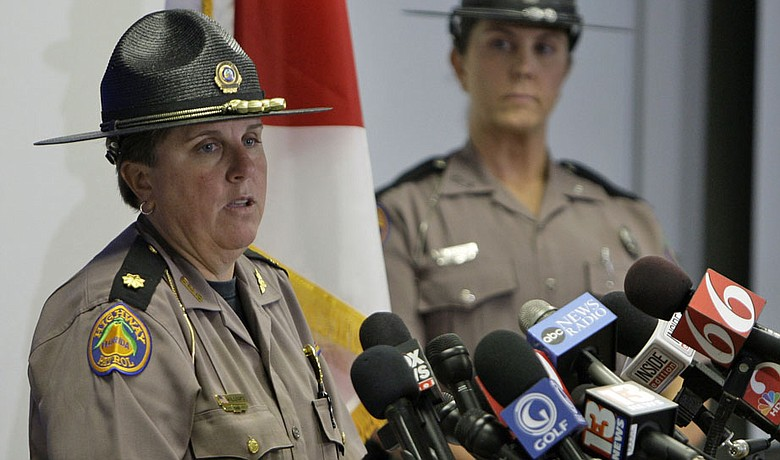 Maj. Cindy Williams (left) with the Florida Highway Patrol during a Dec. 1 news conference concerning Tiger Woods' accident. Sgt. Kim Montes looks on.