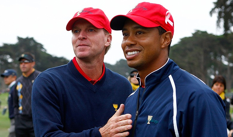 Steve Stricker and Tiger Woods celebrate after Team USA won the Presidents Cup.