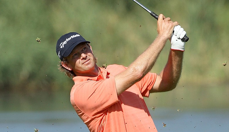 Retief Goosen plays his second shot at the 17th hole during Round 2 of the Nedbank Golf Challenge.