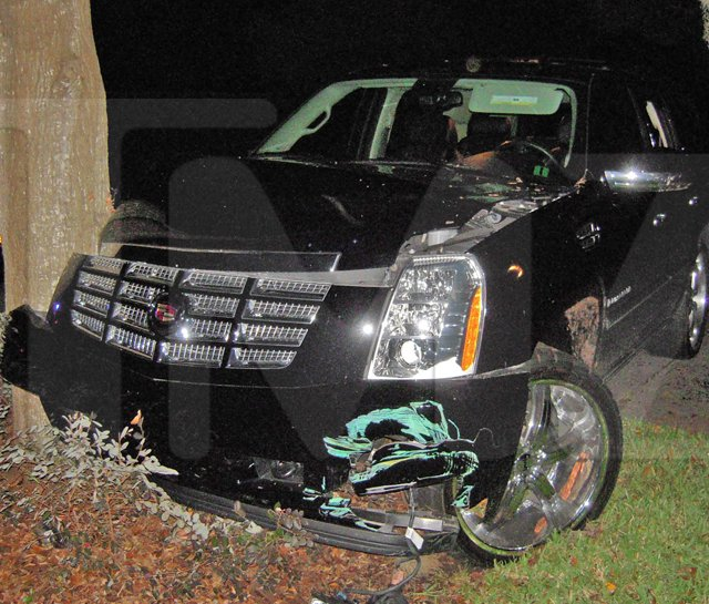 This photo taken Nov. 27 and provided by TMZ.com shows a Cadillac Escalade that Tiger Woods crashed into a tree outside his home in Windermere, Fla.
