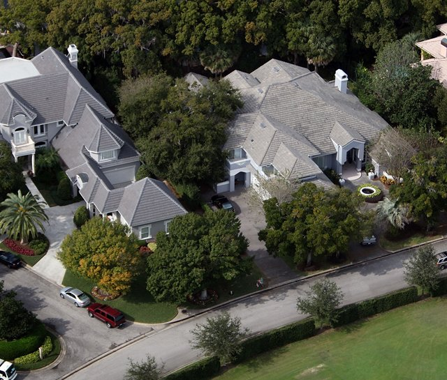 An aerial shot of Tiger Woods' house (left) in Windermere, Fla.