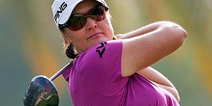 Hjorth takes lead in Dubai; Wie three back