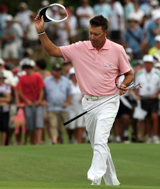 Robert Allenby acknowledges the crowd as he walks up the 18th fairway Dec. 13 at Hyatt Regency Resort.