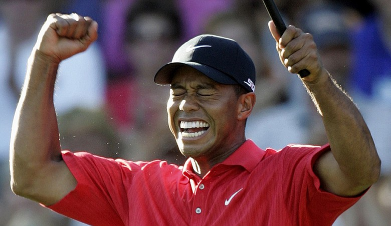 Tiger Woods celebrates after winning the 88th PGA Championship at Medinah Country Club.