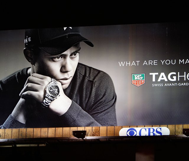Tag Heuer will downscale its use of Tiger Woods image in advertising campaigns for the foreseeable future. 