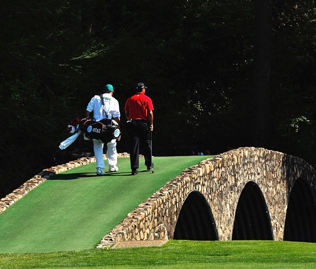 Tiger Woods walks across the Hogan Bridge during the final round of the 2009 Masters. 