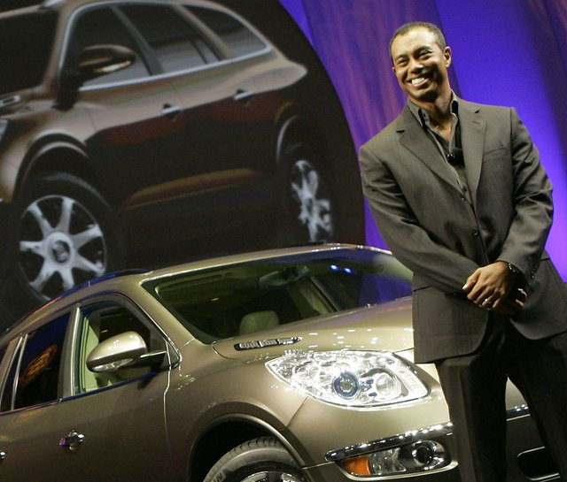 Tiger Woods introduces the 2008 Buick Enclave at the 2006 Los Angeles Auto Show.