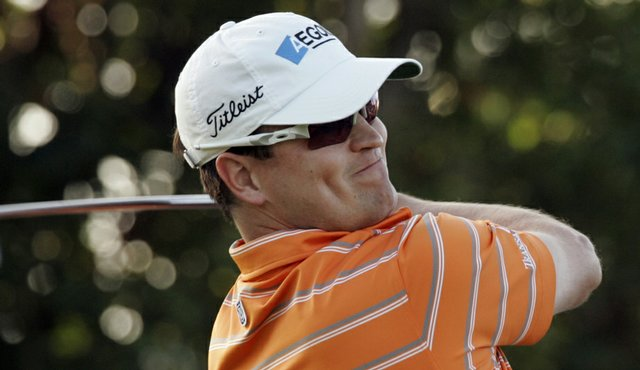 Defending champion Zach Johnson hits off the first tee during Round 1 of the Sony Open.