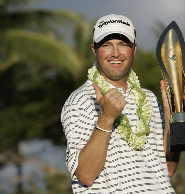 Ryan Palmer holds the trophy after winning the Sony Open.
