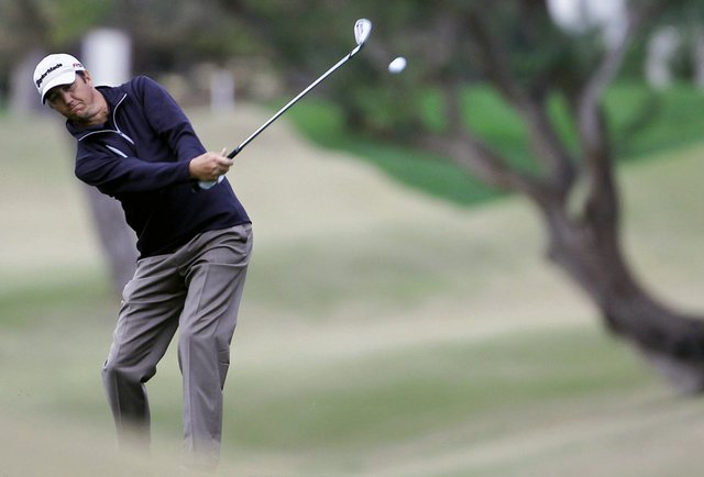 Shane Bertsch watches his shot from the fairway on the ninth hole on the Jack Nicklaus Private Course at PGA West.
