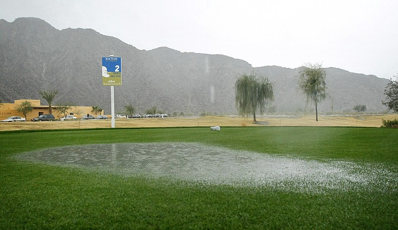 Standing water floods the second tee box Thursday at SilverRock Resort in La Quinta, Calif. Rain has delayed the second round of the Bob Hope Classic.