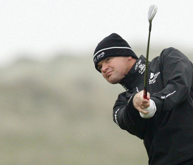 Paul Lawrie plays his second shot into the ninth hole during the first round the 2009 Irish Open.