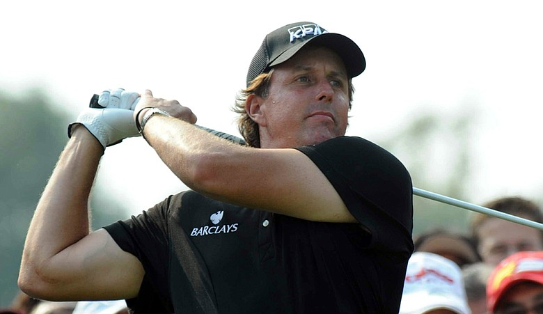 Phil Mickelson tees off during the final round of the HSBC Champions in November.